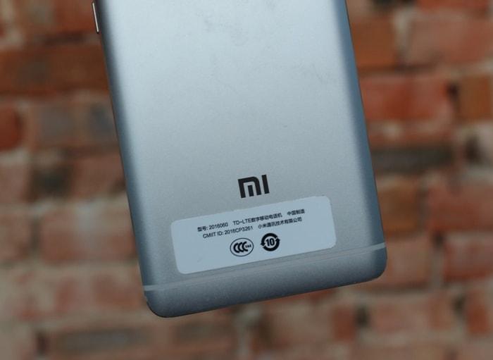 Логотип Mi